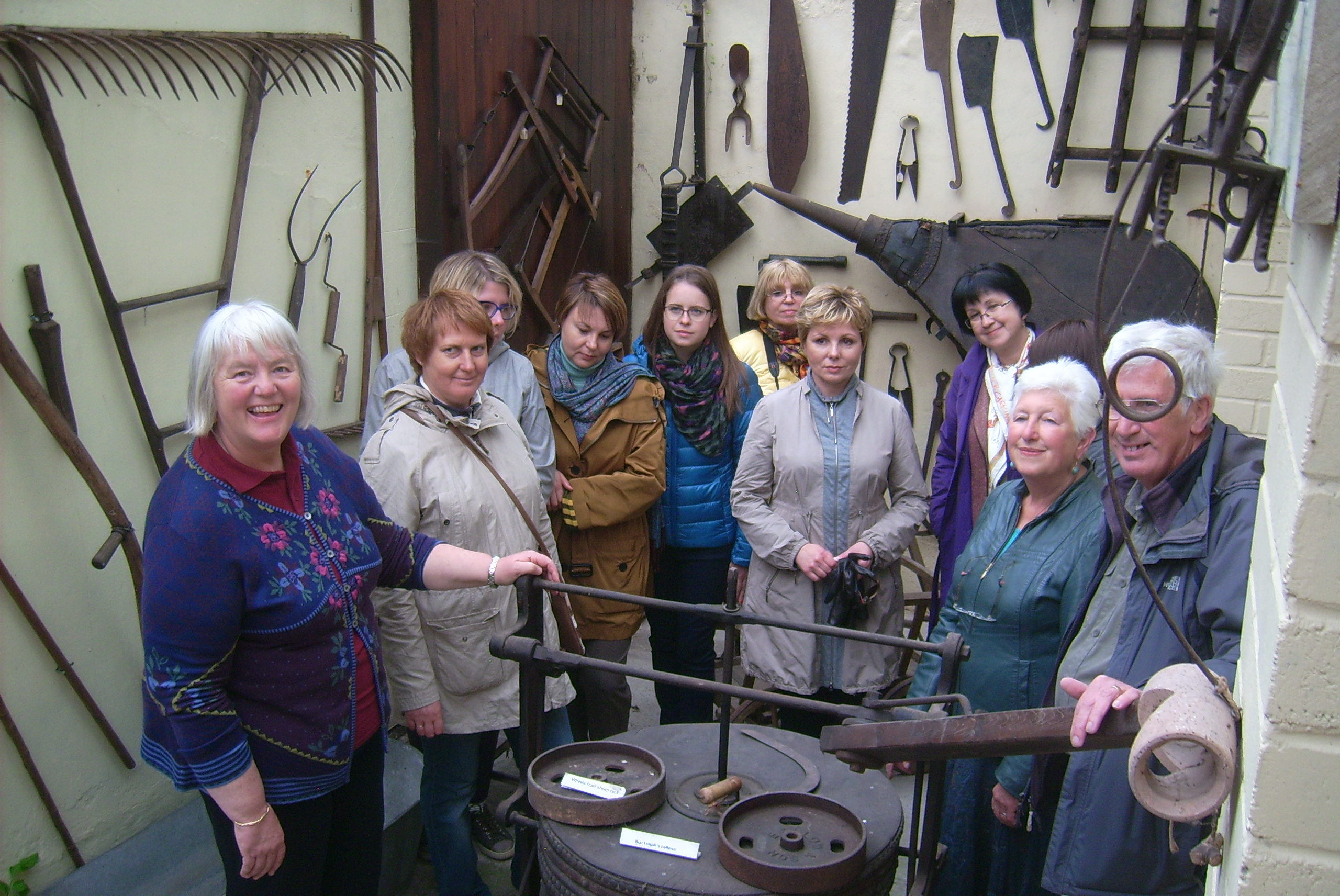 A group photo taking in the display of agricultural implements